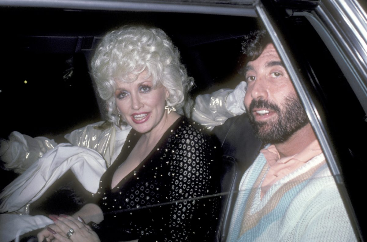 Musician Parton and Manager/Producer Sandy Gallin on October 1, 1985 leaving Rao's Restaurant in New York City, New York.