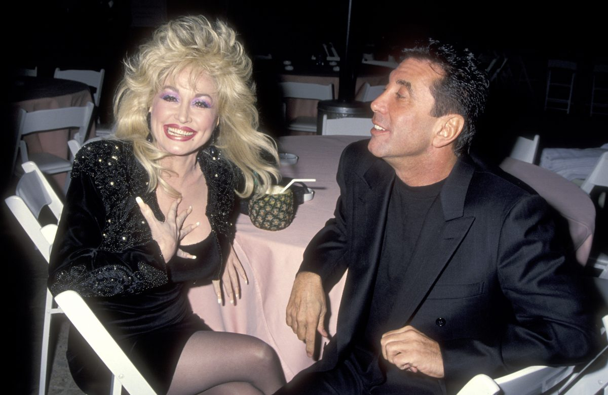 Musician Dolly Parton and Hollywood Manager/Producer Sandy Gallin attend the party to celebrate Kelly Klein's new book, 'Pools,' on November 19, 1992 at the Beverly Hills Hotel in Beverly Hills, California.
