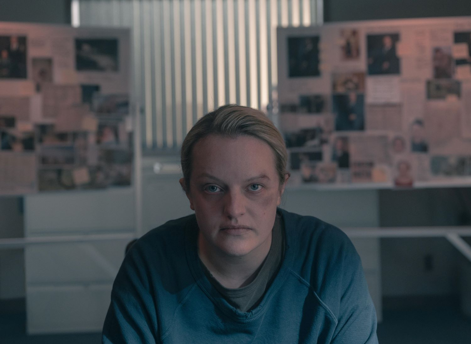 June Osborne wears a blue shirt and stares directly into the camera in 'The Handmaid's Tale'