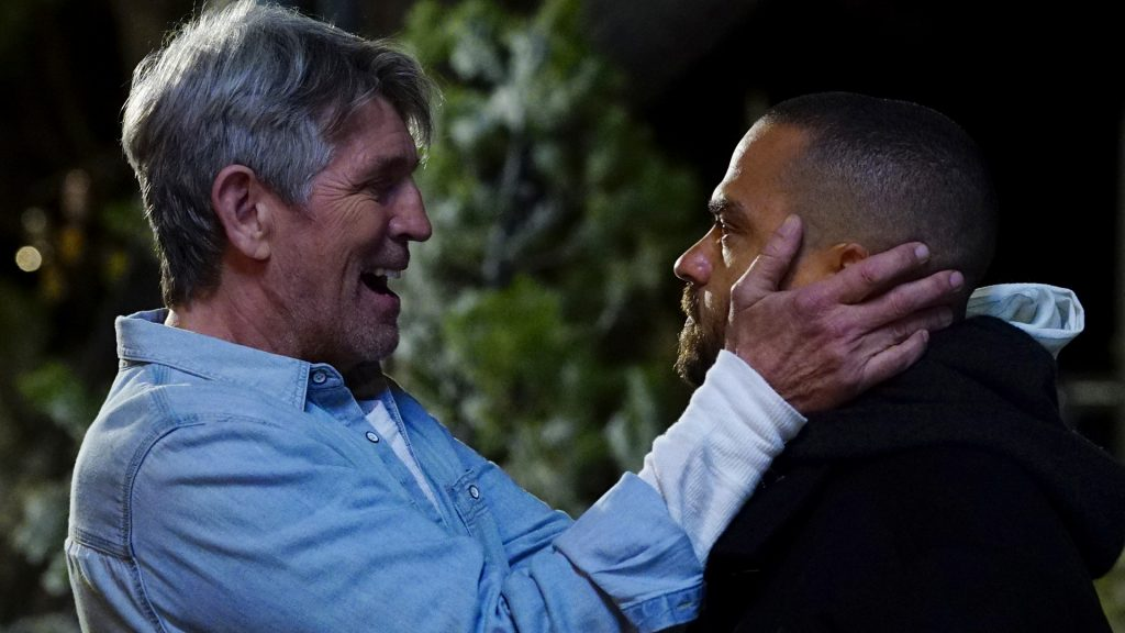 Eric Roberts as Robert Avery holding the face of Jesse Williams as Jackson Avery in 'Grey's Anatomy' Season 13 Episode 16
