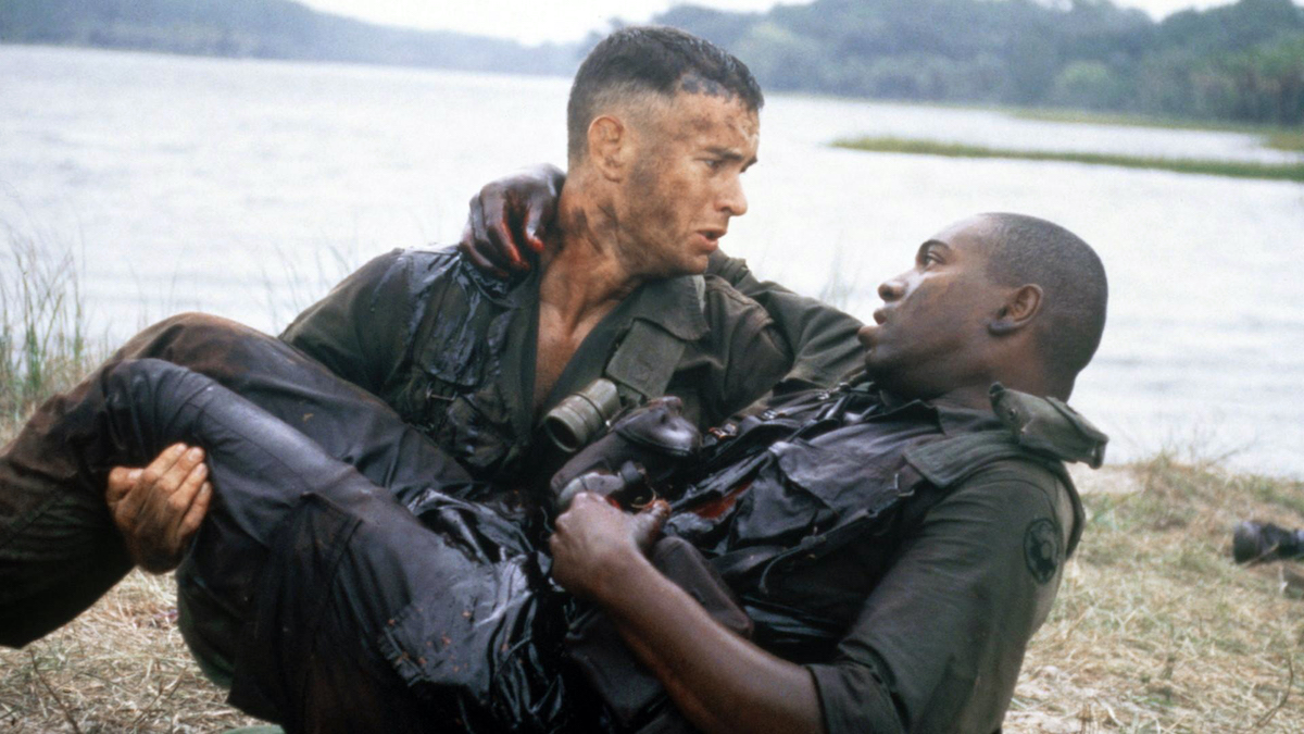 Tom Hanks as Forrest Gump looks down on his wounded friend Bubba (Mykelti Williamson) in a scene from 'Forrest Gump'