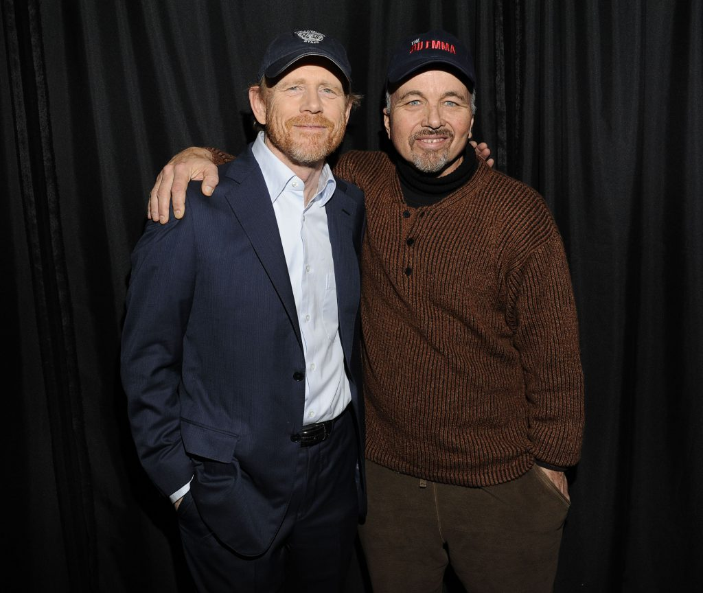 Brothers Ron Howard and Clint Howard pose with arms around each other's shoulders, 2011