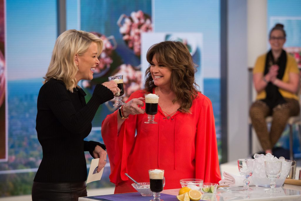 Food Network star Valerie Bertinelli lifts a cup of foamed coffee on the set of 'Today' with Megyn Kelly, 2017