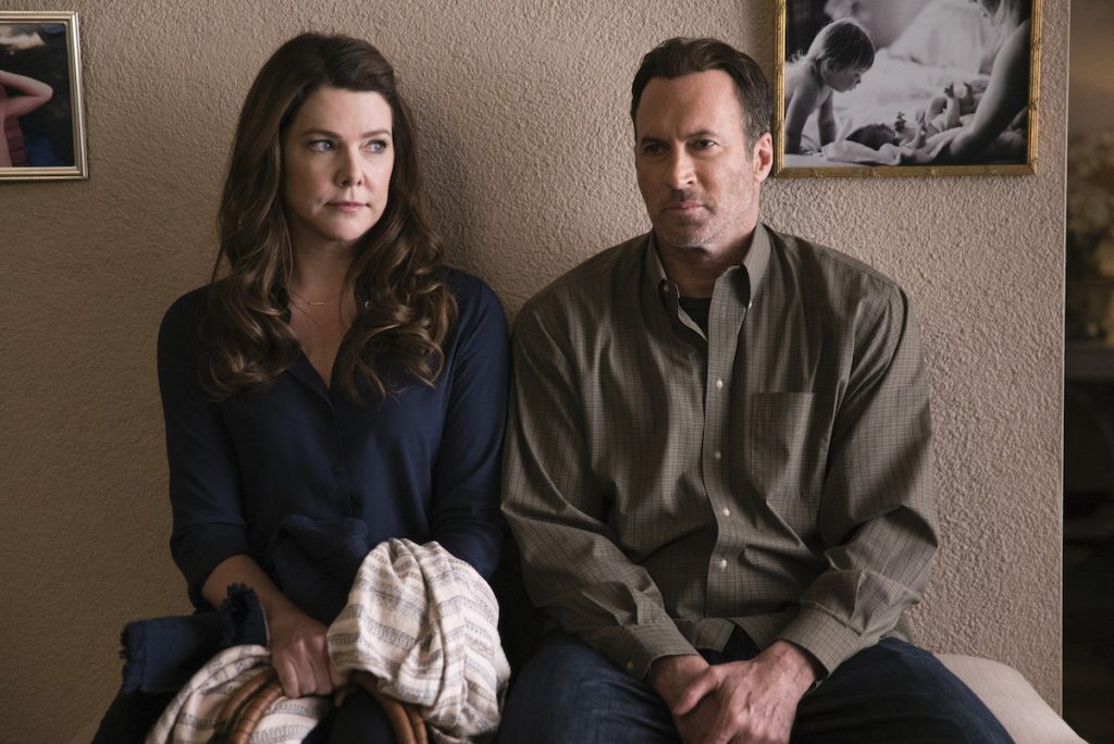 Lauren Graham as Lorelai Gilmore and Scott Patterson as Luke Danes sit next to each other in a doctor's office on 'Gilmore Girls'