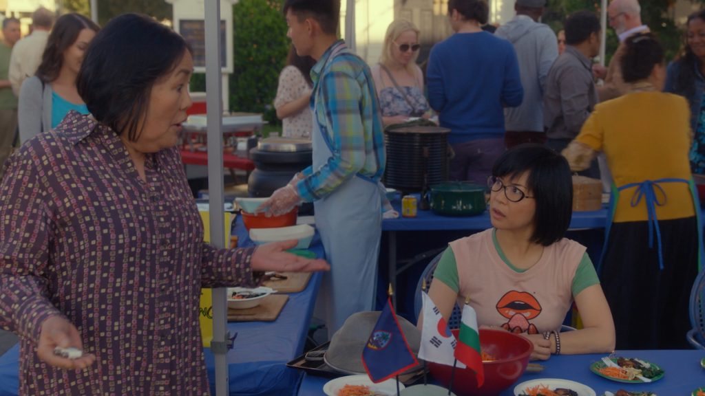 Emily Kuroda as Mrs. Kim and Keiko Agena as Lane Kim talk to each other at a festival in 'Gilmore Girls: A Year in the Life'