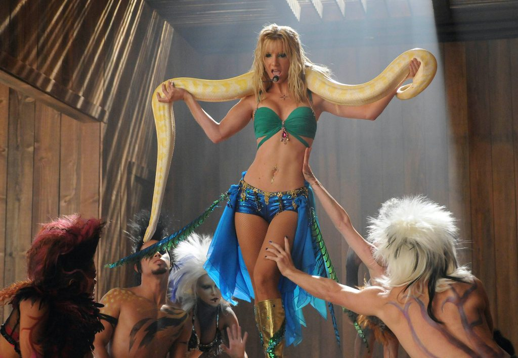 Heather Morris holding a snake around her neck on 'Glee'
