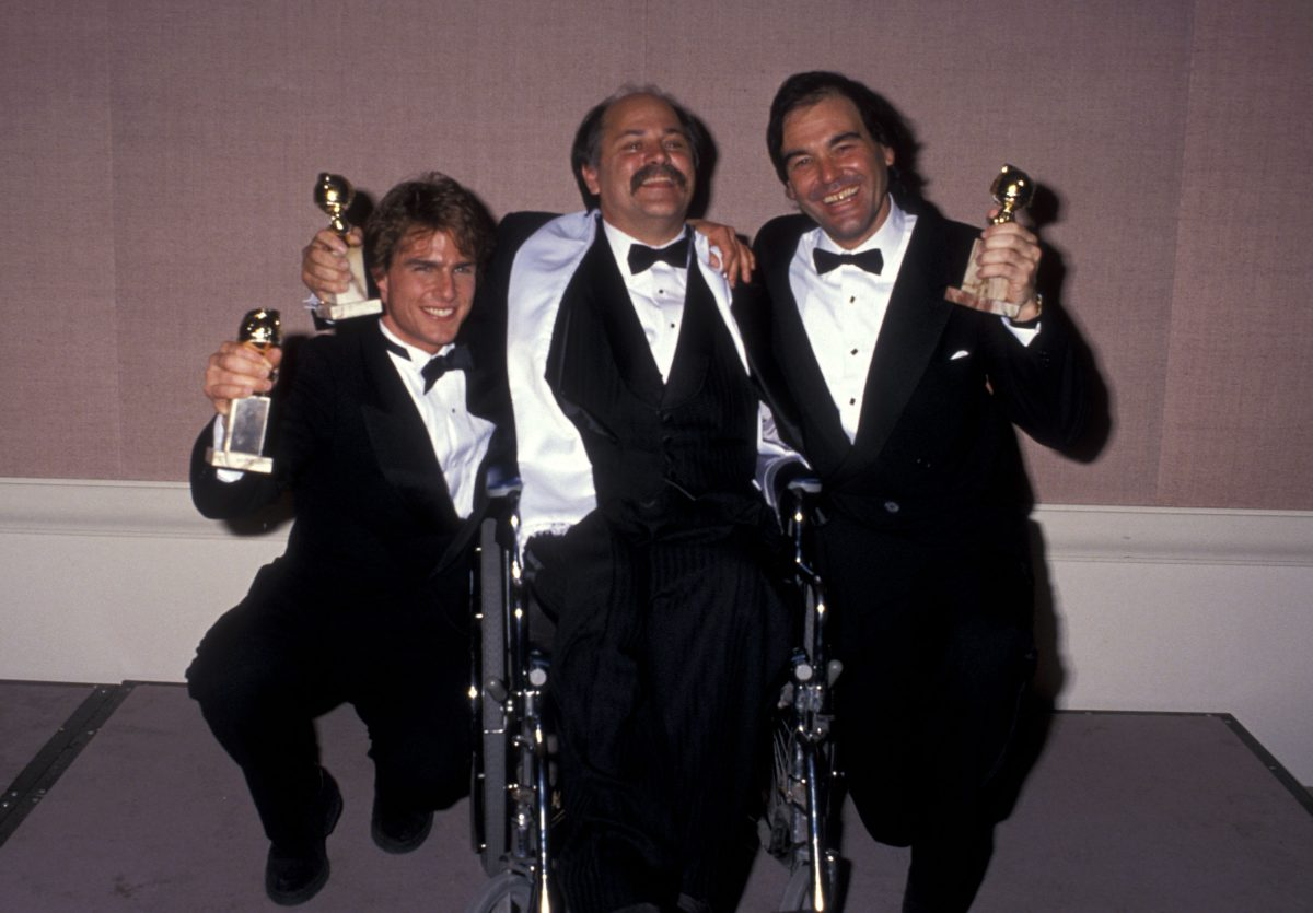 Golden Globe winners Tom Cruise, Ron Kovic and Oliver Stone hold their awards