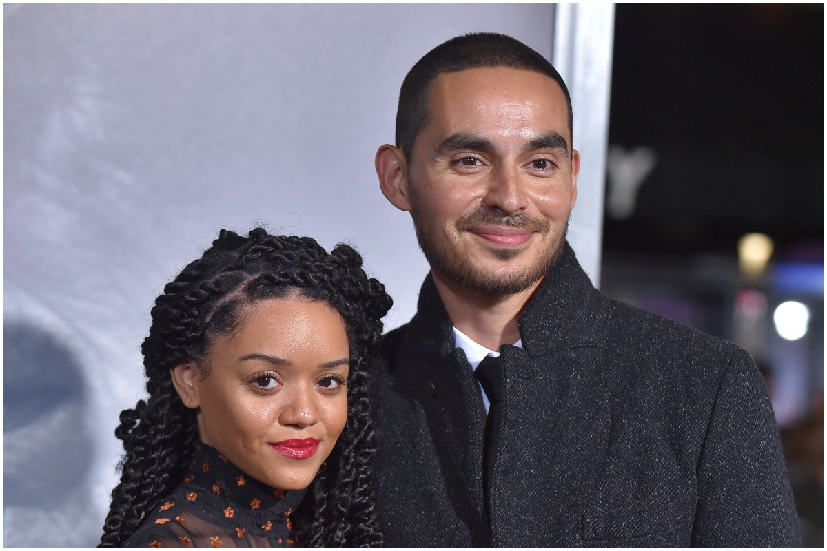 'Good Girls' star Manny Montana smiling with his wife, Adelfa Marr, at an event.