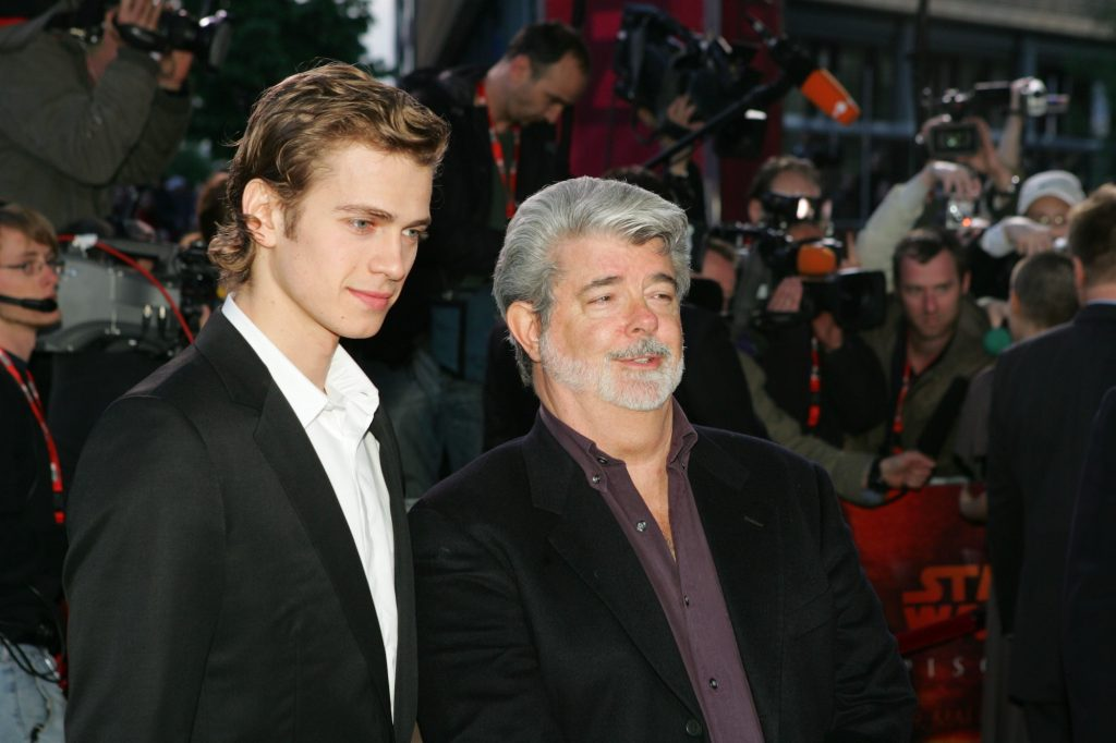 (L-R) Hayden Christensen and George Lucas in front of a crowd