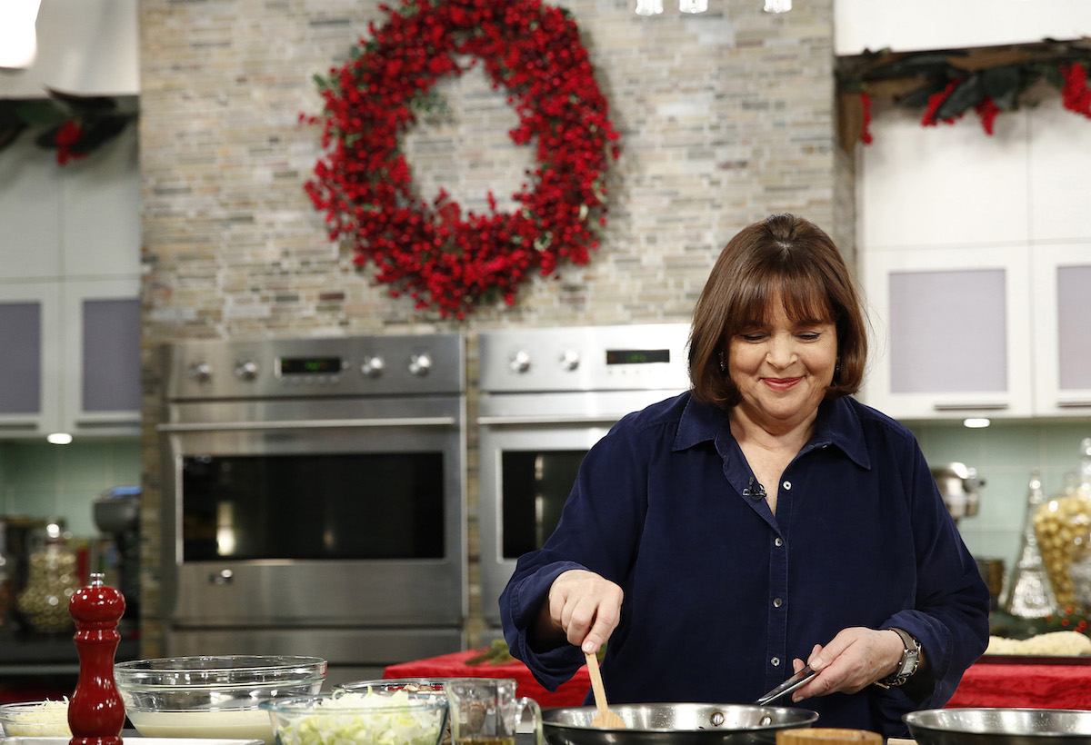 Ina Garten is stirring a pot while she cooks on