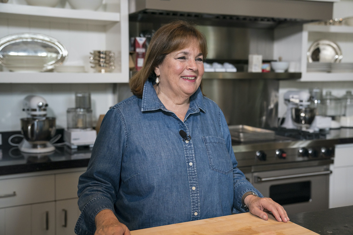 """Barefoot Contessa Ina Garten smiles as she stands in front of the counter inside the """"barn"""" on her property in East Hampton, New York."""