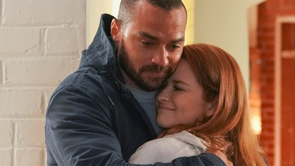 Jesse Williams as Jackson Avery and Sarah Drew as April Kepner hugging in 'Grey's Anatomy' Season 17 Episode 14, 'Look Up Child.'