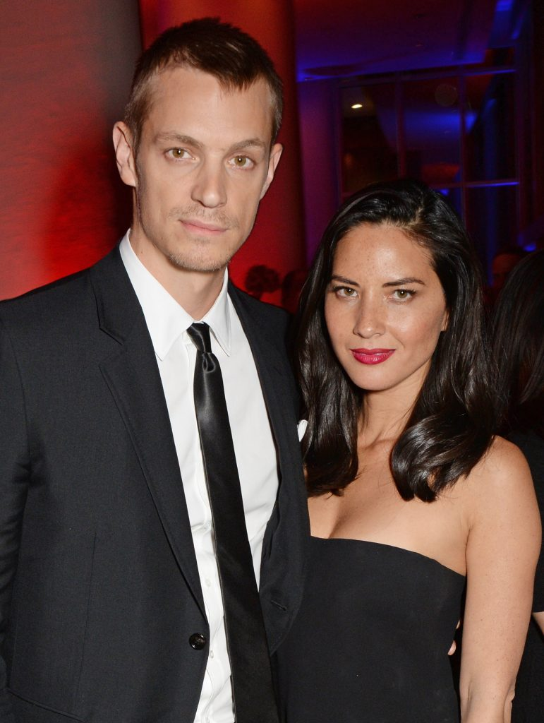 Joel Kinnaman and Olivia Munn pose for a picture at the after party of the world premiere of RoboCop in 2014