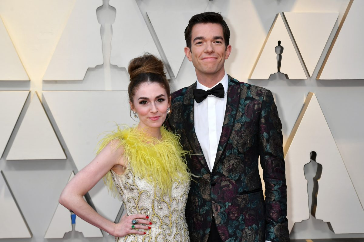 Annamarie Tendler and John Mulaney pose for photos after arriving at the 91st Annual Academy Awards in 2019