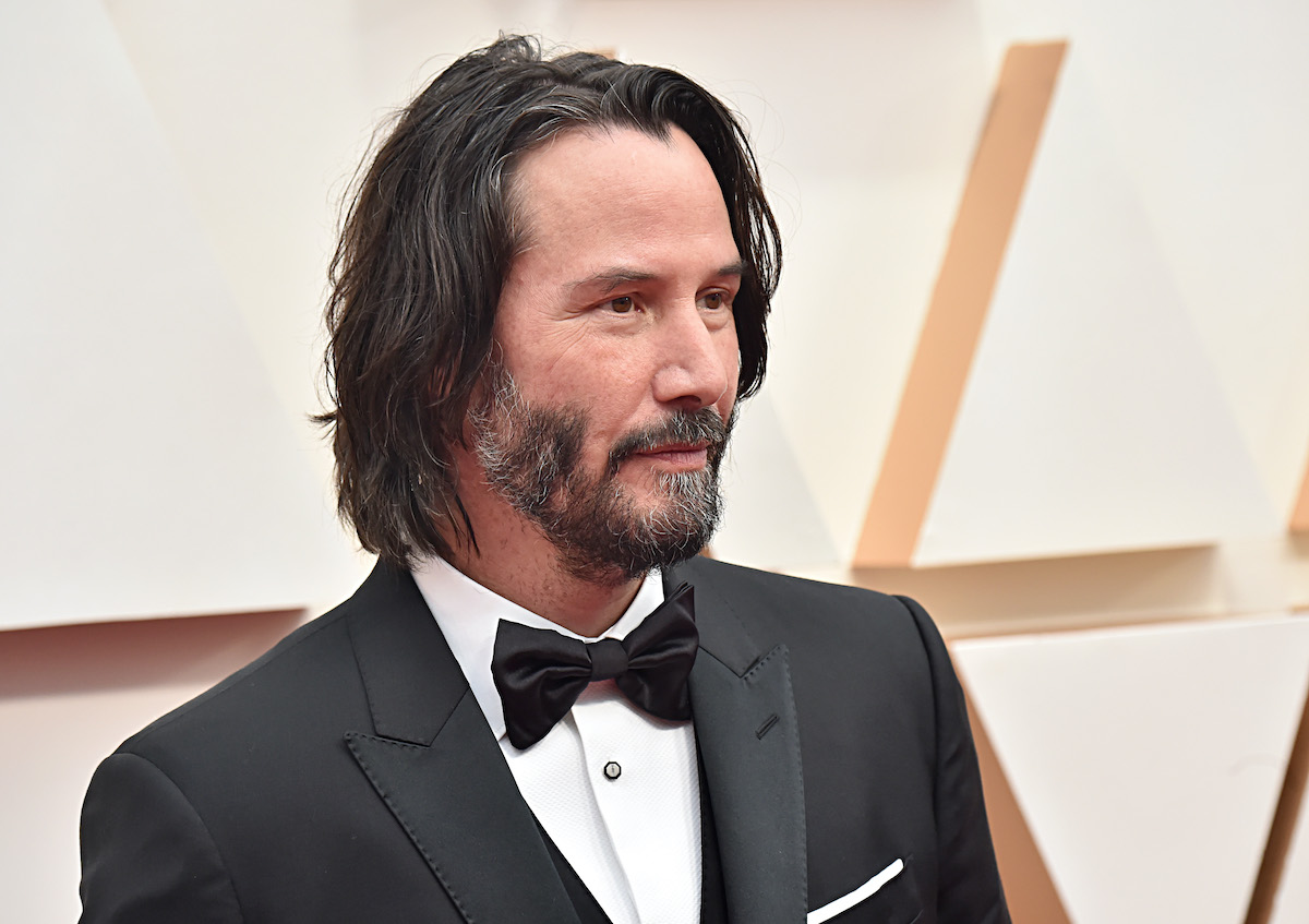 Keanu Reeves poses at the 92nd Annual Academy Awards