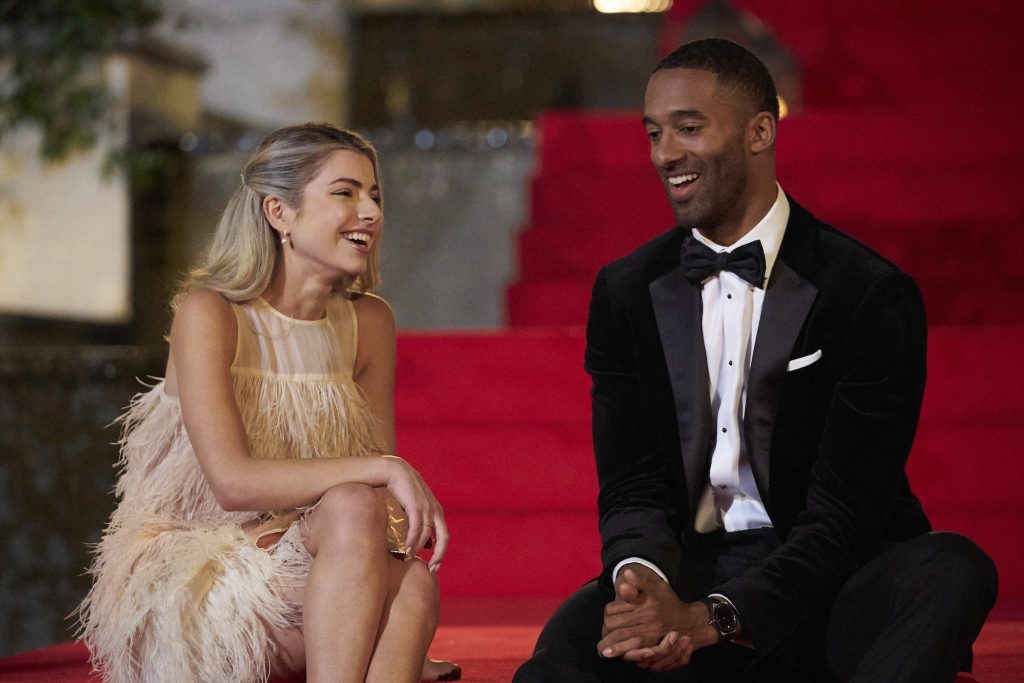 Kit Keenan and Matt James dressed in fancy clothing sitting next to each other on the first night of 'The Bachelor'