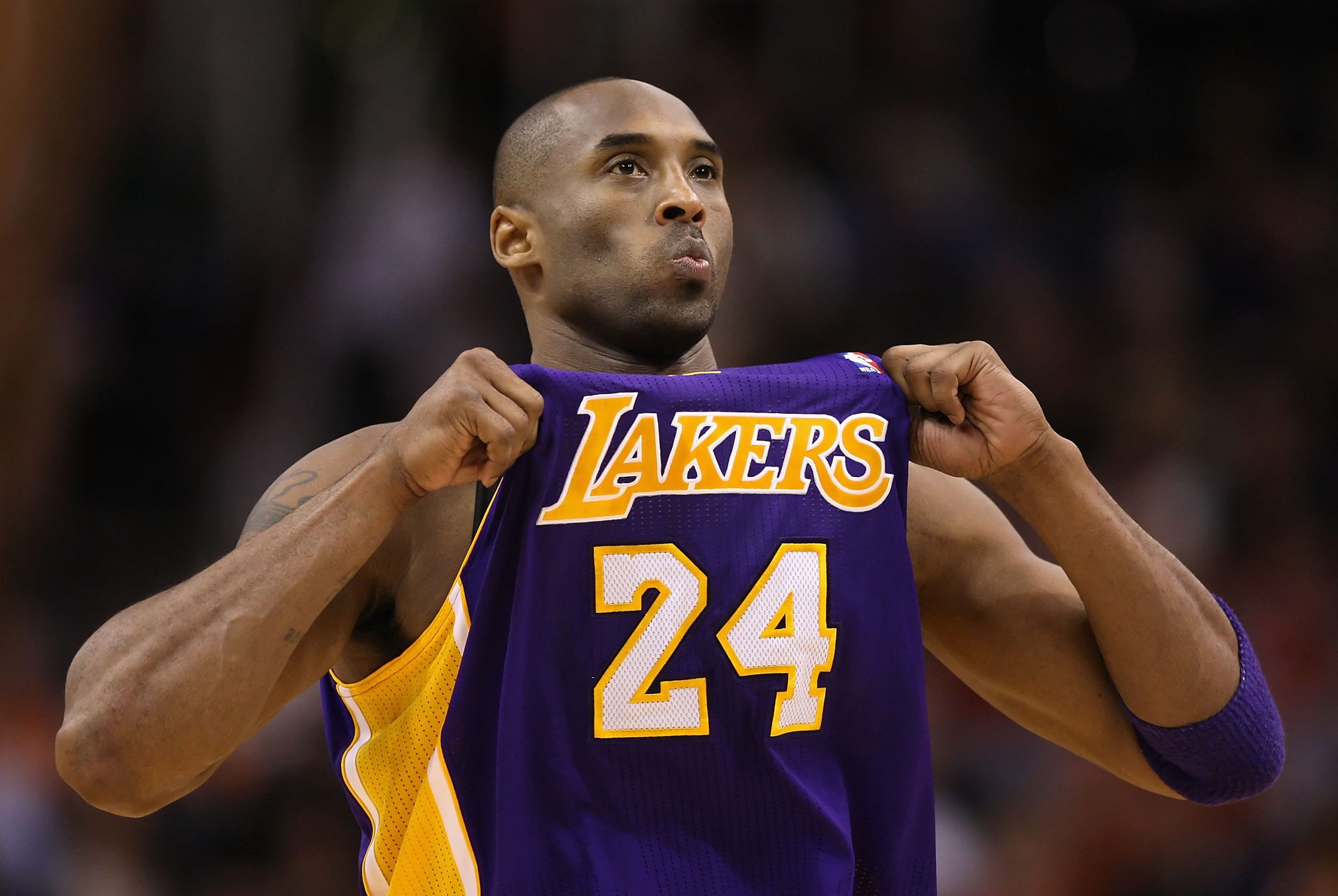 Kobe Bryant holds up his Lakers jersey for the crowd crowd at US Airways Center on February 19, 2012.
