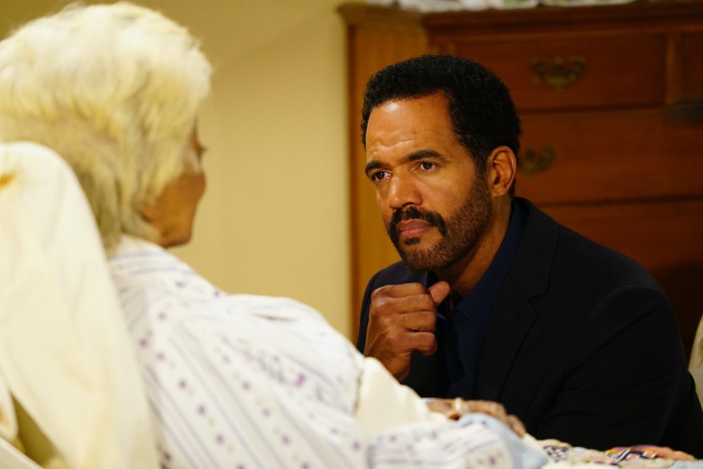 Kristoff St. John sitting at a hospital bedside on 'The Young and the Restless'