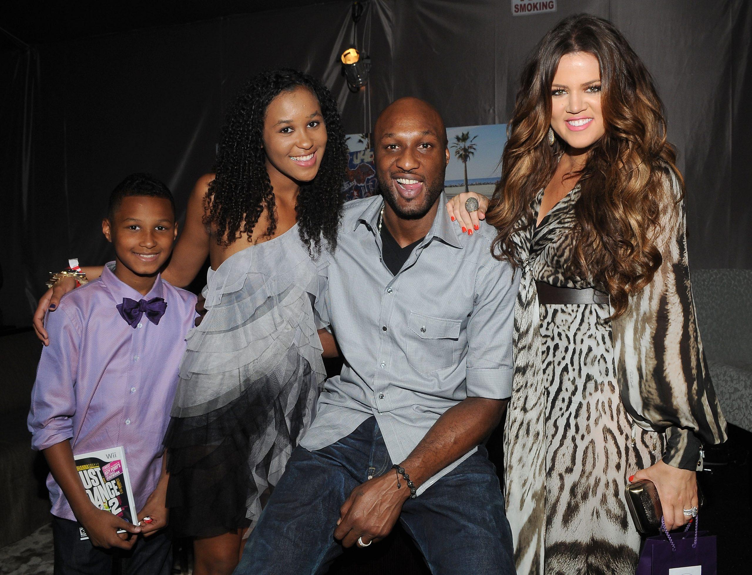 Lamar Odom and Khloé Kardashian smiling with his kids Destiny Odom and Lamar Odom Jr at an awards show.