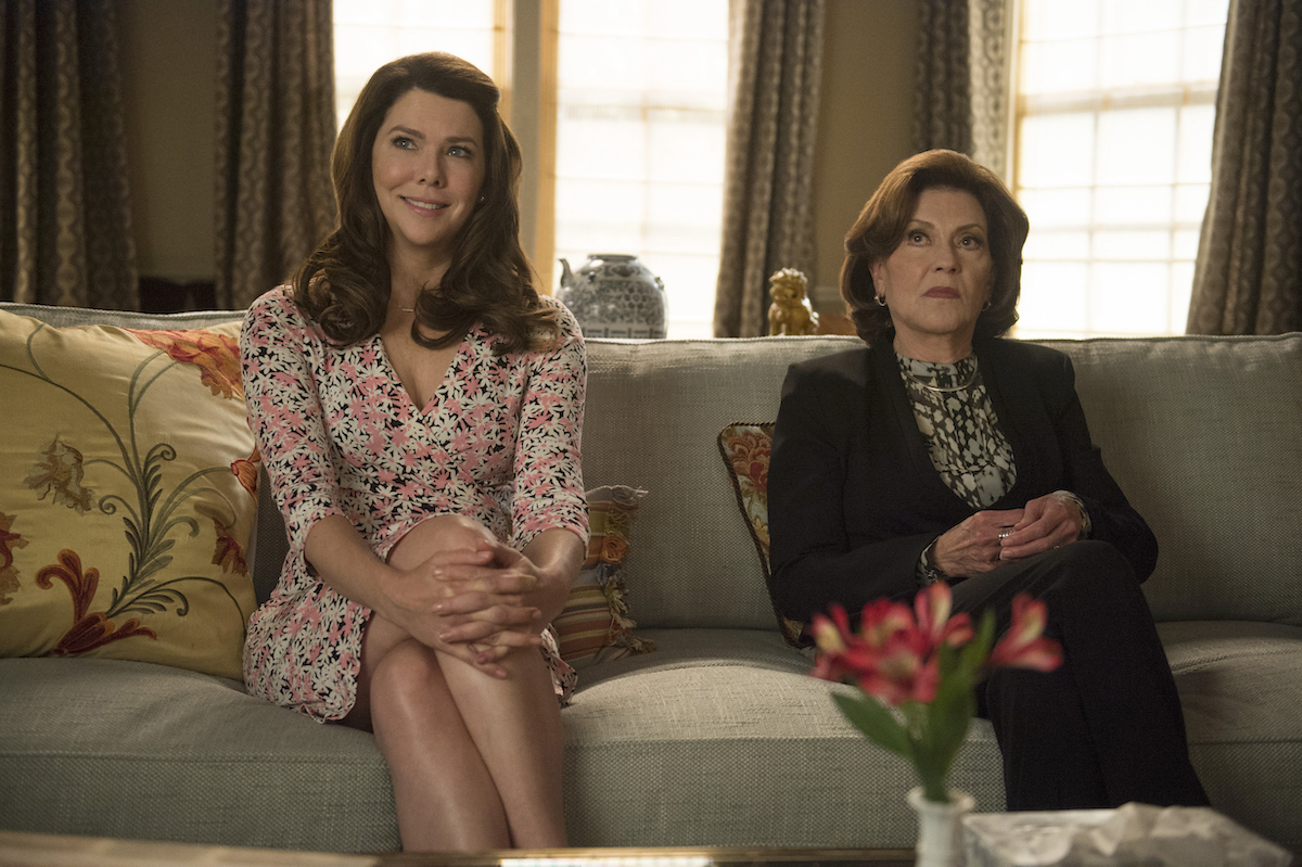 Lauren Graham as Lorelai Gilmore and Kelly Bishop as Emily Gilmore sit next to each other on a couch during a scene from 'Gilmore Girls: A Year in the Life'