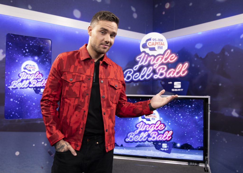 Liam Payne from One Direction in a red jacket
