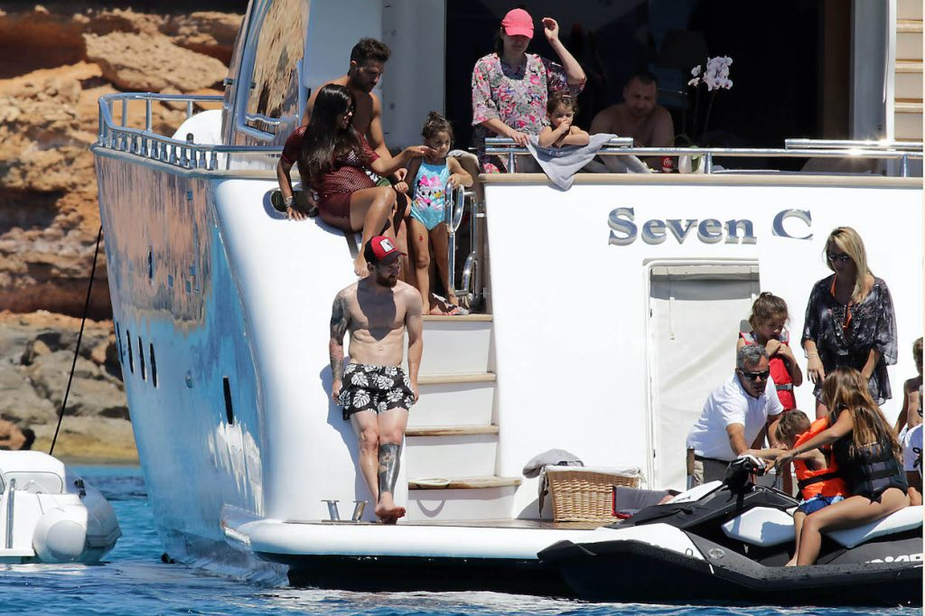 Lionel Messi, Cesc Fabregas and their families are seen in Ibiza