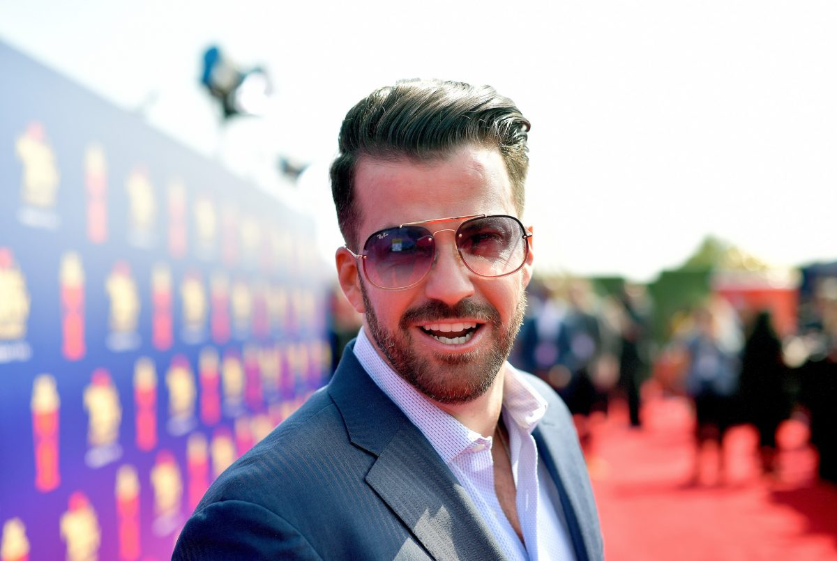 Johnny 'Bananas' Devenanzio from MTV's 'The Challenge' wearing a suit and sunglasses looking into the camera at the 2019 MTV Movie and TV Awards