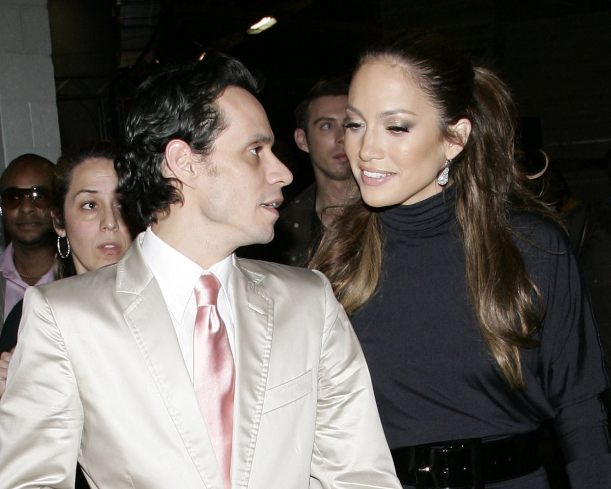 Marc Anthony speaking to Jennifer Lopez while attending a red carpet event.