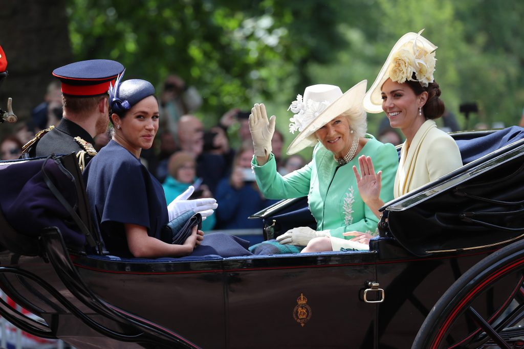 Meghan Markle, Camilla Parker Bowles, and Kate Middleton riding in a carriage during Trooping The Colour 2019