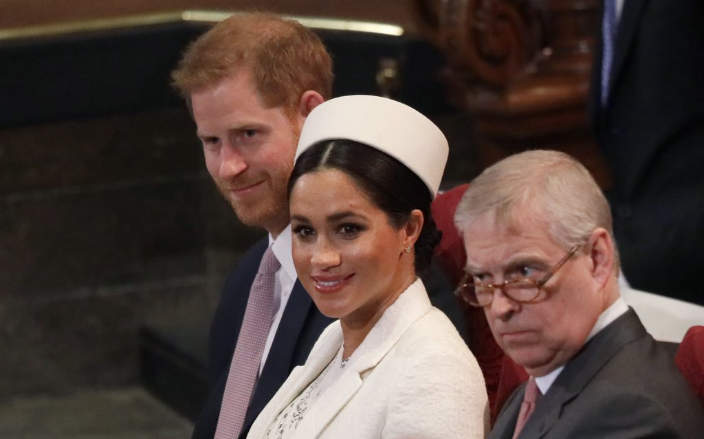 Meghan Markle, Prince Harry, and Prince Andrew, sitting together during the Commonwealth Service at Westminster Abbey in 2019