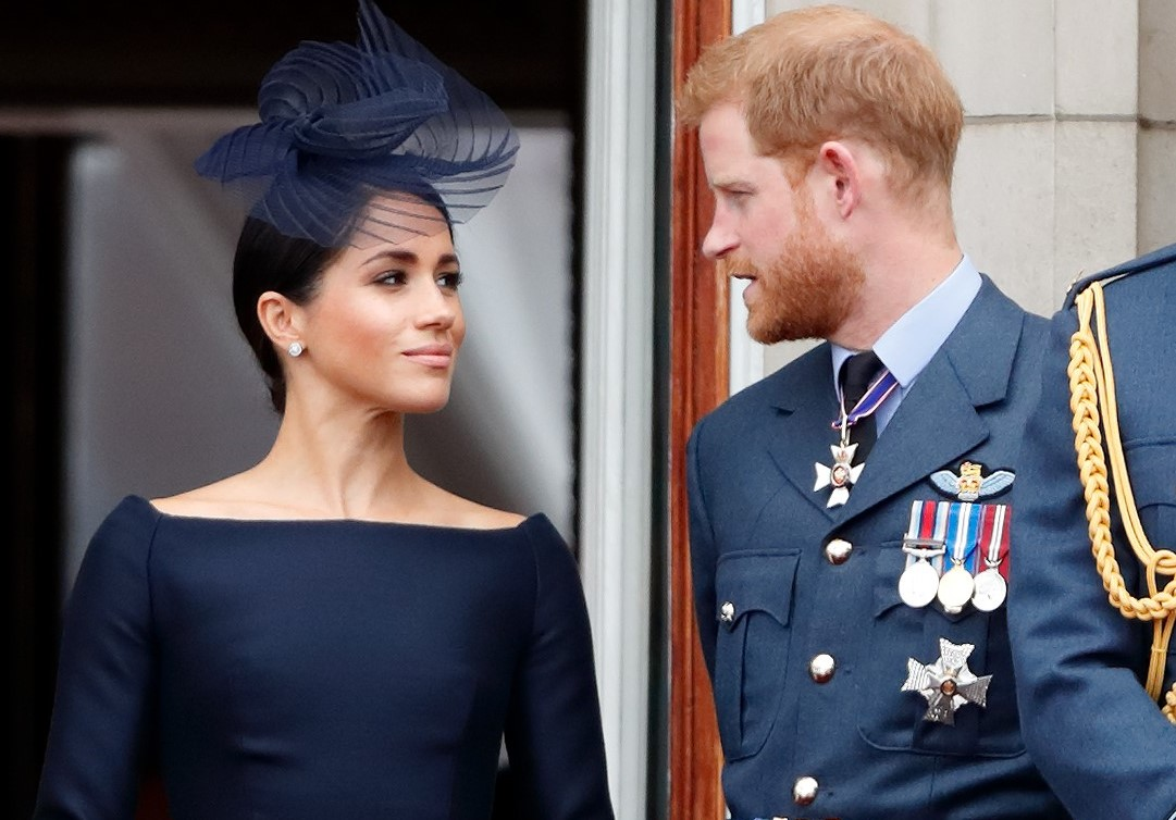 Meghan Markle and Prince Harry staring at one another on the Buckingham Palace balcony during Trooping the Colour