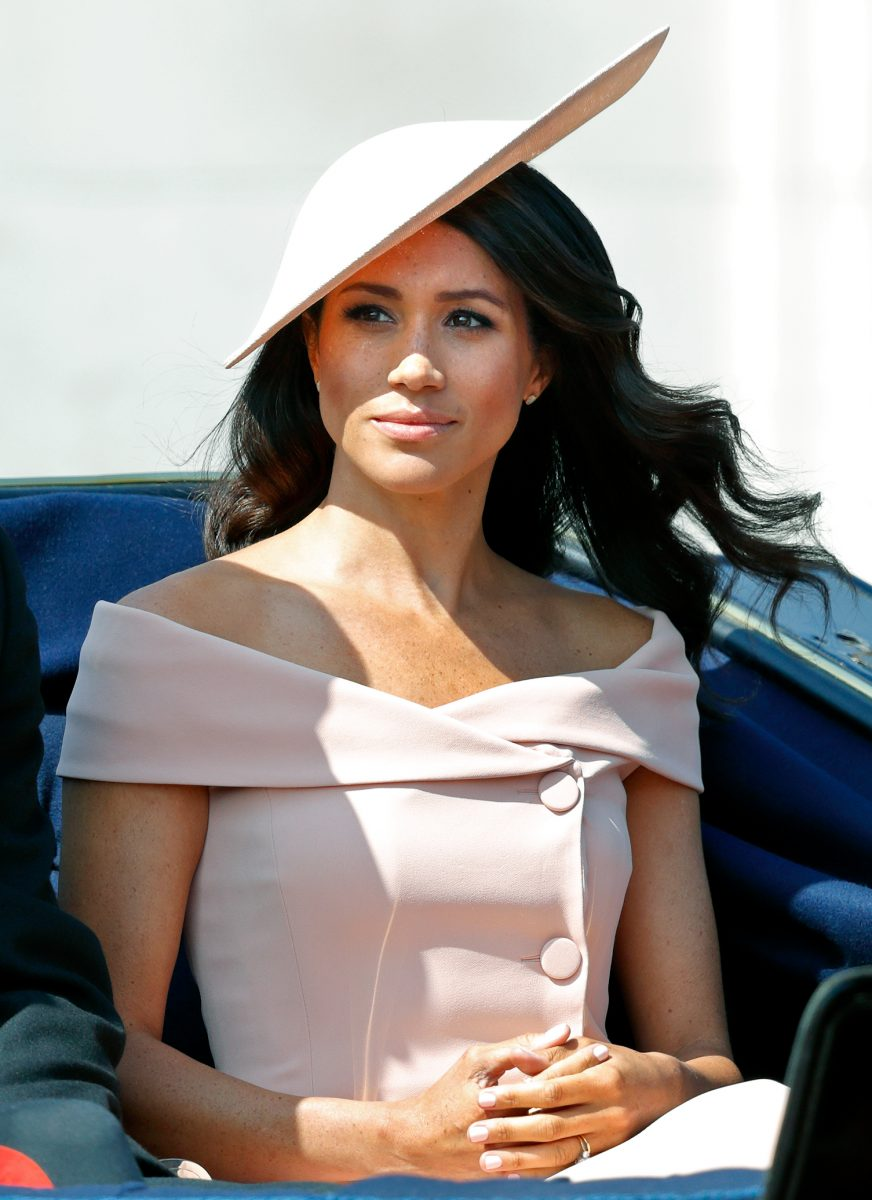 Meghan Markle dressed in a pink hat and fascinator in a horse drawn carriage during Trooping The Colour