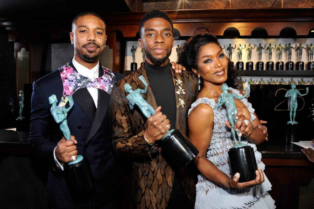 Michael B. Jordan, Chadwick Boseman, and Angela Bassett pose together with their Screen ActorsGuild Awards statues