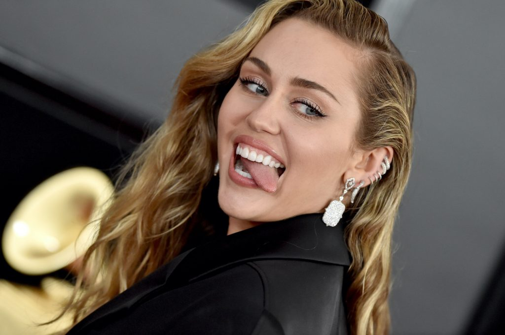 Miley Cyrus sticking out her tongue, turned to the camera