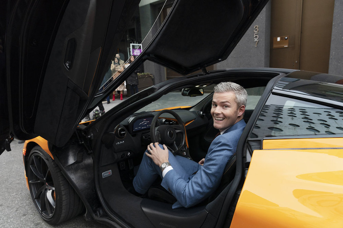 Ryan Serhant sits in a luxury car during Million Dollar Listing New York sales