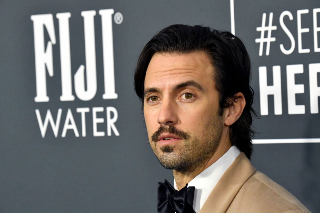'This Is Us' star Milo Ventimiglia walks the red carpet for the 25th Annual Critics' Choice Awards in a tan suit with a black tie. He's looking off in the distance.