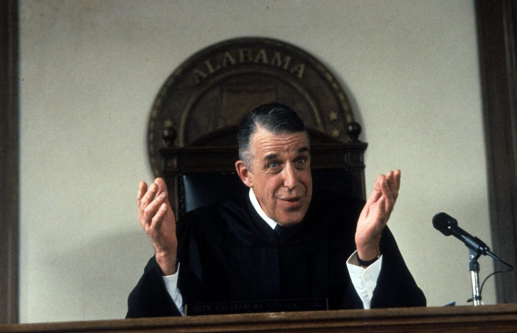 Fred Gwynne as Judge Chamberlain Haller sits at the Judge's bench in 'My Cousin Vinny'