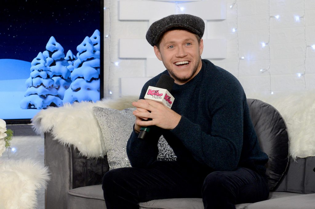 Niall Horan wearing a hat during an interview