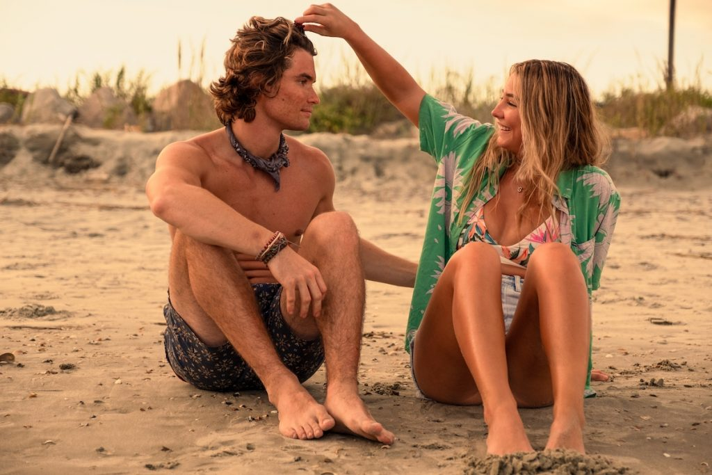 Chase Stokes as John B. and Madelyn Cline as Sarah Cameron on the beach in a production still from 'Outer Banks' Season 2 on Netflix