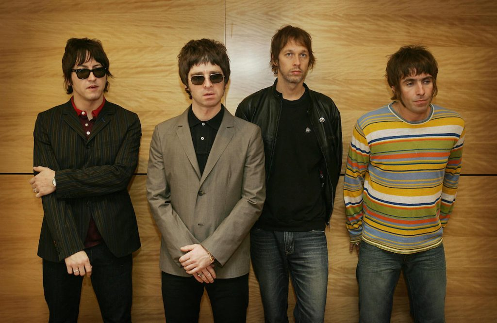 """From L-R Gem, Noel Gallagher, Andy Bell and Liam Gallagher, members of the British rock band """"Oasis"""" hold a photocall in Hong Kong 25 February 2006.  The Band are to hold a concert 25 February."""