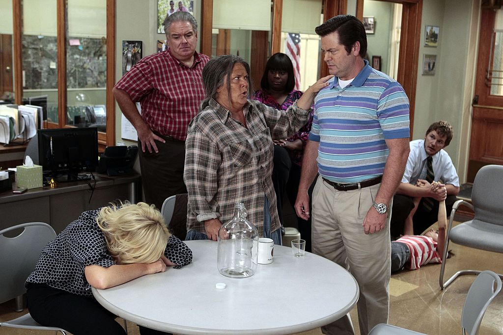 Amy Poehler as Leslie Knope, Paula Pell as Tammy 0, and Nick Offerman as Ron Swanson are all reacting to disappointing news while in the parks office.