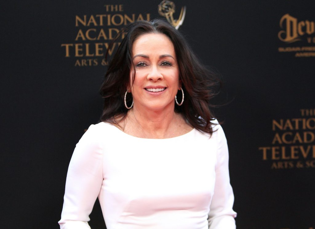 Patricia Heaton of 'Everybody Loves Raymond' wears a white dress and smiles for cameras as she attends the 43rd Annual Daytime Creative Arts Emmy Awards at Westin Bonaventure Hotel