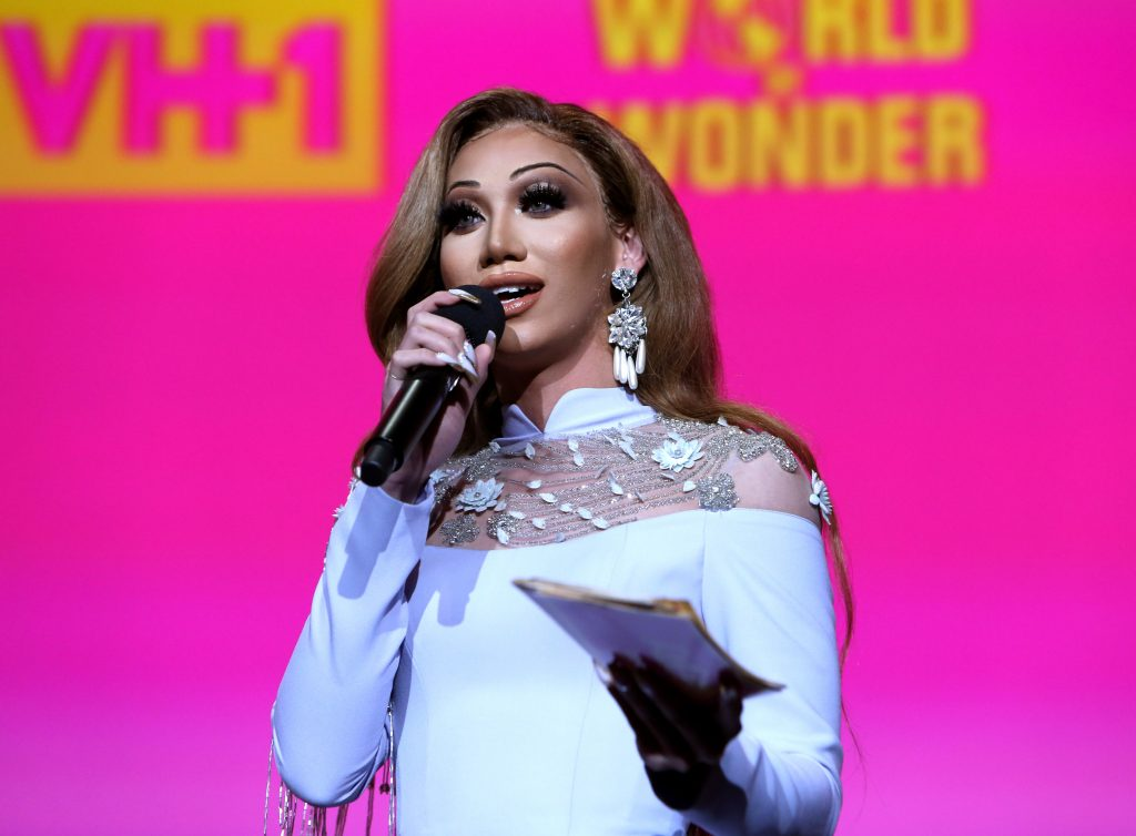 Plastique Tiara speaks on stage during 'RuPaul's Drag Race' - Emmy FYC Panel in a white dress