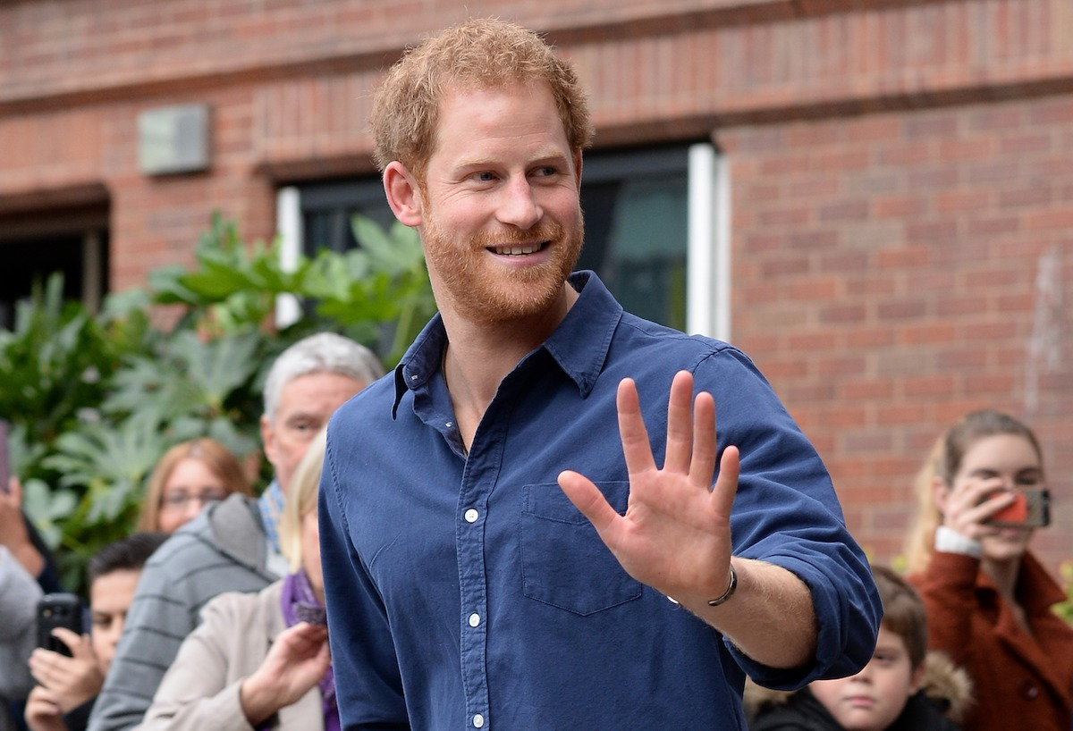 Prince Harry waves as he leaves Nottingham's new Central Police Station