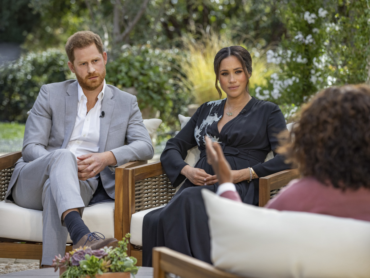 Prince Harry and Meghan Markle sit next to each other as they get interviewed by Oprah Winfrey in 2021