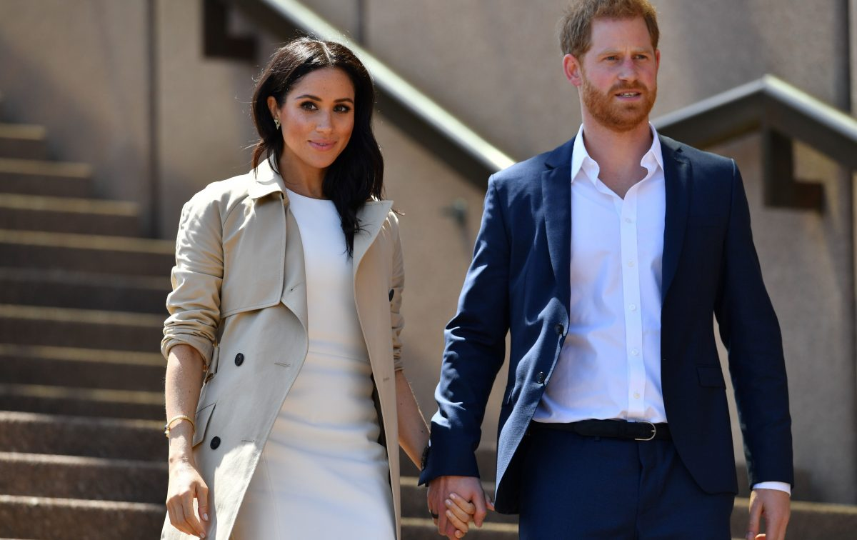 Prince Harry and Meghan Markle walk down the stairs of Sydney's Opera House to meet people