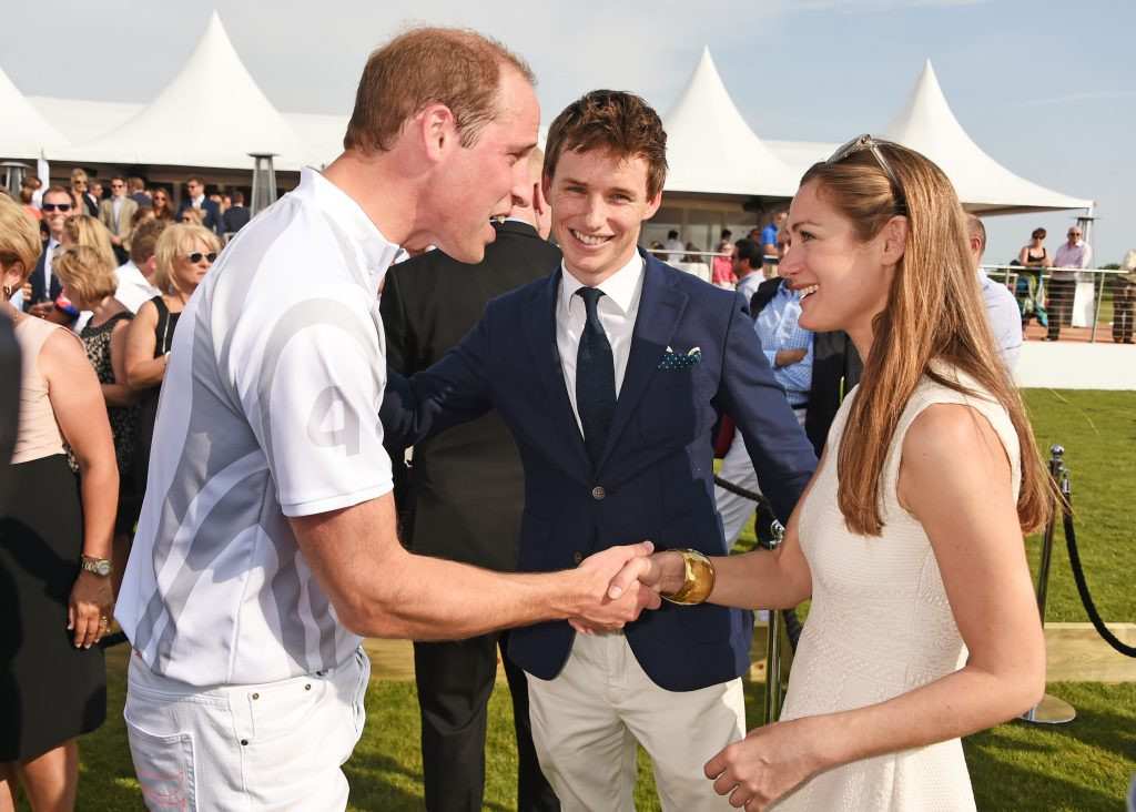 Prince William greeting Eddie Redmayne and his wife, Hannah Bagshawe, at the Audi Polo Challenge in 2015