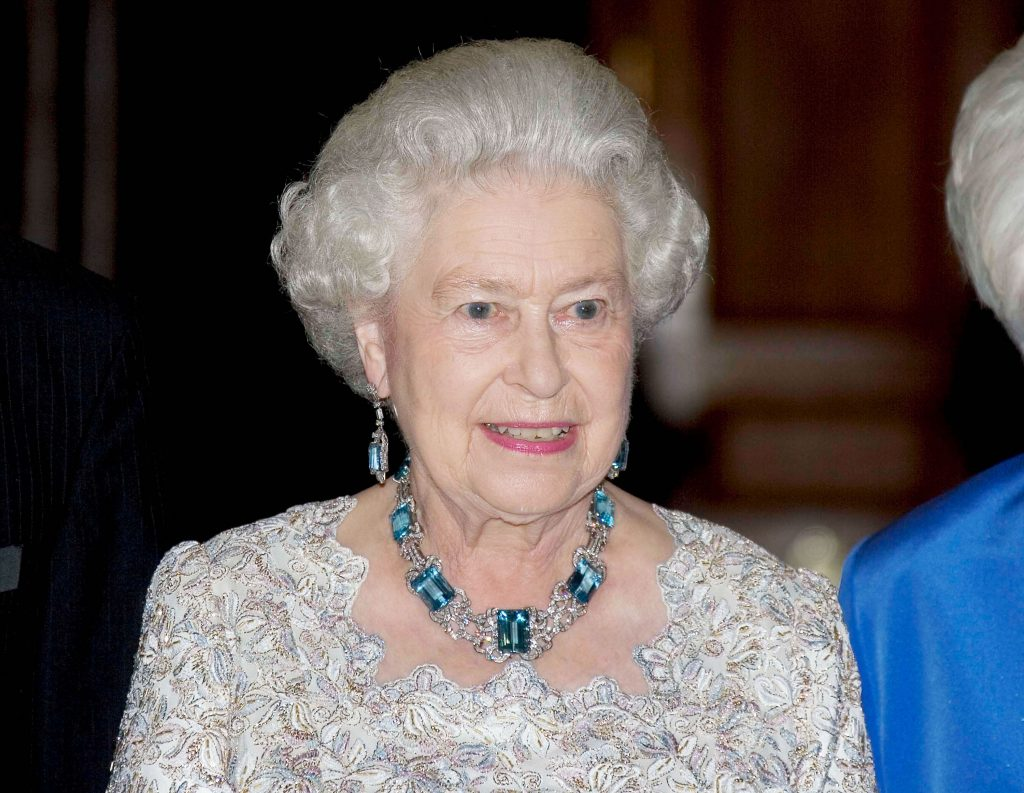 Queen Elizabeth II wearing aquamarine earrings and necklace to dinner party