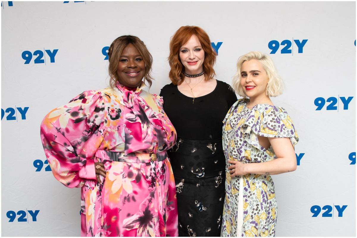(L-R): 'Good Girls' stars Retta, Christina Hendricks, and Mae Whitman posing and smiling on the red carpet.