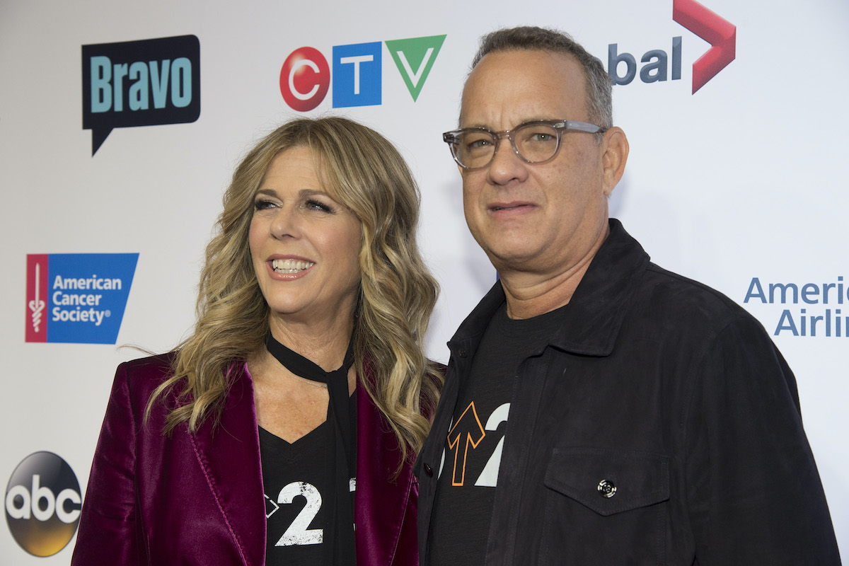 Rita Wilson and Tom Hanks pose at a red carpet event